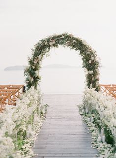 Photography : Vasia Photography | Flowers : I am Flower Read More on SMP: http://www.stylemepretty.com/2017/02/28/this-just-might-be-the-prettiest-ceremony-spot-youll-ever-lay-eyes-on/