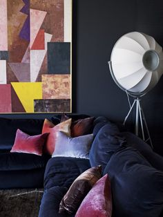 blue velvet sofa with crushed velvet sofa and abstract geometric artwork in Christian Lyon's Perth home // living rooms