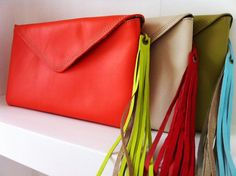 "Clutch/Cartera de Sobre $70 DESCRIPTION 11.75"" width x 6.25"" height. Leather clutch, fabric lined inside. Magnetic clasp closure. Includes a..."