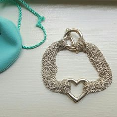 ✨HPx7✨ TIFFANY & CO multi strand heart bracelet Authentic tiffany & co sterling silver bracelet. Wore only 2 times and just had it deep cleaned at the Tiffany & Co Waikiki location on 3/10/2015. (I have the receipt and paperwork for the cleaning) In great condition. Comes with shopping bag, pouch and box. Chain length is 7.5 inches. 925 metal purity. Tiffany & Co. Jewelry Bracelets
