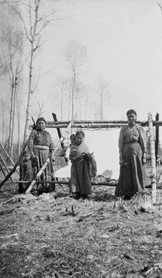 Chipewyan group preparing a Moose hide - 1918