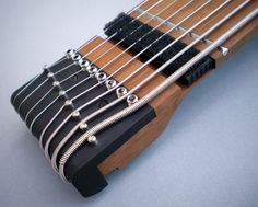 """NS/Stick 8-string 34"""" scale multi-mode guitar/bass in Ash with 4 Active EMG pickups, dark bamboo neck, and precision tapping frets"""