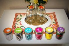Encouraging good behavior. Different colored beads from category jars go into the big jar to earn rewards.