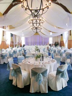 Madeleine and Peter's January wedding had a soft and fresh blue and white scheme, perfect for the stunningly hot and beautiful Hawkes Bay Day. Fresh white marquee canopy with blue lights, frosted baby blue sashes and centrepieces of silver, crisp white and soft blue provide a classic and fresh look.