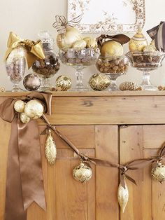 DIY Holiday Mantel.  You only need ornaments, ribbon, and glass goblets. #lulusholiday