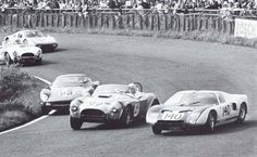 "Close fight between Ferrari 250 GTO, Shelby Cobra and Ford GT in the ""Südkehre"" 1964"