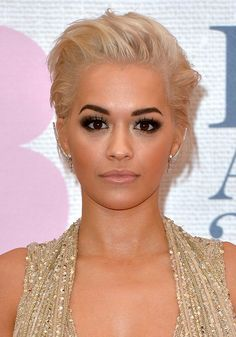 Rita Ora rocked nude lips with chocolate-brown smokey eyes [Getty]