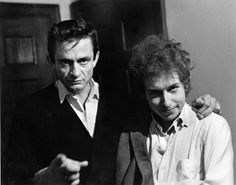 Skillful use of the cardigan without allowing it confine the collar. - Johnny Cash (with Bob Dylan a little too disheveled)