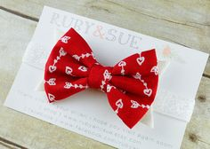 Cupid's Arrow Hair Bow, Fabric & Felt Bow Headband, Valentine's Day Accessory. $10.95, via Etsy.