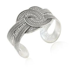 Silvertone Double Circle Detailed Theme Cuff Bracelet Crystal Knot Rain Jewelry. $14.99. Silver tone metal. Crystal studded accents. Metal bends sligtly to acommodate different wrist sizes. Width of bracelet at widest (center knot) 1.25""