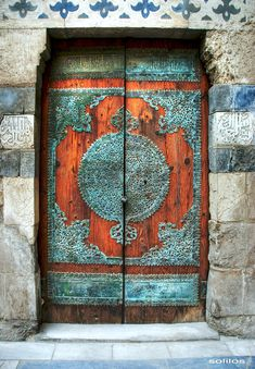 Door in Cairo, Egypt - Wooden door at Mausoleum, Madrasa-Khanqah of Sultan al-Zahir Barquq, Funerary Complex at Al-Mu'izz Street, Cairo, Egypt - Photo by Amr Soliman - https://www.flickr.com/photos/solilos/484876727/