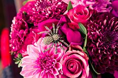 Teeny sparkly spider tucked into the bride's bouquet...