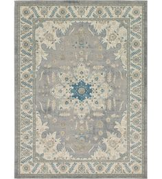 Anchor your dining room ensemble or add an elegant touch to the foyer with this lovely rug, showcasing a traditional Persian-inspired motif.