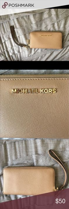 Michael Kors wallet/ wristlet Beige, medium size, great condition Michael Kors Bags Wallets