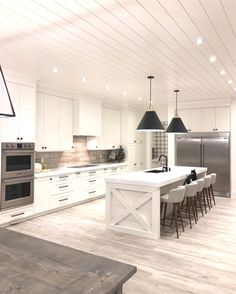 wood floors in kitchen bronze pendant lighting creamy white cabinets paired with supreme quartzite inspiration a house we built my living interior design is the definitive resource