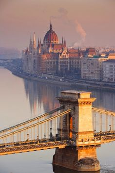 Sunrise over the Szechenyi Chain Bridge in Budapest, Hungary.