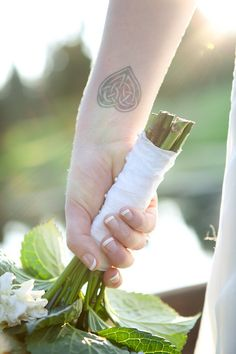From Kristen and Mike's wedding.  I love her beautiful Celtic heart tattoo.