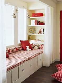 Love the built-in shelves, wide window seat and drawers. Also love the lights and curtains to hide it all away.