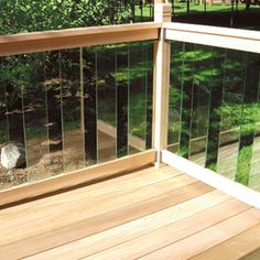 A glass deck railing allow you an unrestricted view of your backyard. A glass deck railing in your deck can add an elegant touch of style to your home. Wood Deck Railing, Deck Railing Design, Glass Railing, Deck Design, Railing Ideas, Patio Stairs, Outdoor Deck Decorating, Outdoor Decor, Balustrades