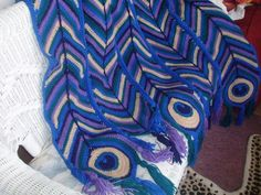 """Peacock Splendor afghan made by Kathryn from a design by Sheri L Jacobsen in the book """"Afghan Enchantment""""."""