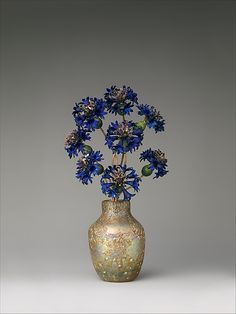 FABERGÉ~ Imperial Cornflowers House of Carl Fabergé, Saint Petersburg, ca. 1900–05. Gold, silver, enamel; blown and iridized glass by the Imperial Glass Manufactory. Part of a series of gemstone life like flowers created by Fabergé.