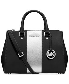 Mix and match a MICHAEL Michael Kors handbag, wallet and pom charm to create her perfect holiday gift.