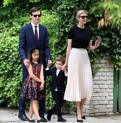 Smile and a wave: The couple were seen heading to shul with their children Arabella and Joseph