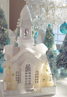Winter white christmas snow church with bell tower flocked glittery snow with LED lit cathedral windows and bottle brush trees with white picket fence. White Christmas Snow, Noel Christmas, Christmas Crafts, Christmas Decorations, Christmas Glitter, Vintage Decorations, Christmas Stockings, Christmas Ideas, Christmas Village Houses
