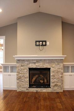Home fireplace - Awesome Built In Cabinets Around Fireplace Design Ideas – Home fireplace Modern Fireplace Tiles, Fireplace Redo, Fireplace Remodel, Brick Fireplace, Living Room With Fireplace, Fireplace Surrounds, Fireplace Design, Modern Fireplaces, Fireplace Ideas