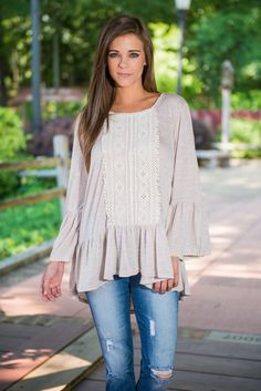 It's really no wonder why you love this top so much! It has some gorgeous crochet detailing down the front and on the hem of the sleeves. It has very romantic bell sleeves and a fab ruffled hemline. Plus, it's cotton blend fabric is thin and soft!