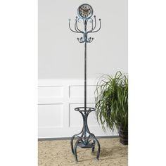 Uttermost Generosa Coat Rack 26127. h1Uttermost Generosa Coat Rack 26127_h1pThis wonderful Uttermost Generosa Coat Rack 26127 features forged iron in crackled turquoise with weathered black undertones and a lightly antiqued clock face under glass._p. See More Clothes Stands at http://www.ourgreatshop.com/Clothes-Stands-C1082.aspx