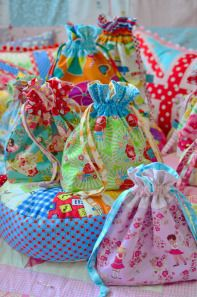 Fabric Bags. I love all these color combinations!