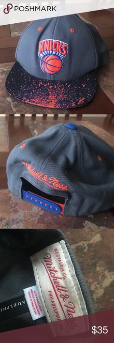 vintage Mitchell and Ness knicks snapback hat Hat is dark grey with a black bull that has orange and purple paint splatter details Mitchell and Ness Accessories Hats