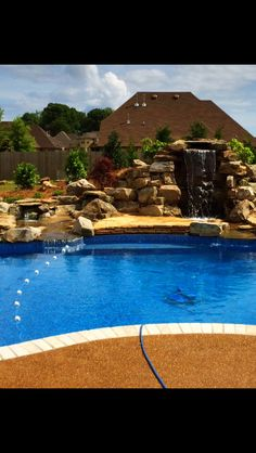Multiple falls with a center patio/jumping area between. The tall waterfalls on the right has a grotto behind the falls with a custom stone bench. Stone Bench, Natural Swimming Pools, Ponds, Waterfalls, Patio, Outdoor Decor, Nature, Home, Natural Pools