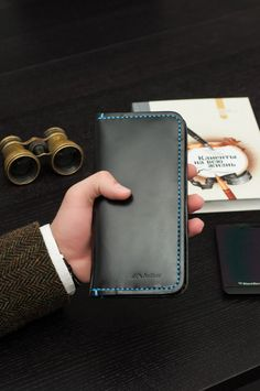 This slim breast wallet is made of high quality calf leather. It is perfect solution to keep your everyday essentials in one place. The wallet is 100% handmade in our smoke and pet free studio.  These is unisex and makes the perfect gift for all occasions. We can engrave anything on wallet, just let us know at checkout. ______________________________________________________________  Features Include:  1. Unisex 2. ID holder 3. 12 credit card pockets 4 3 open slots for cash or cell phone etc…
