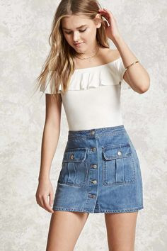 A denim mini skirt featuring a button front, two front button-flap pockets, and a flared hem.