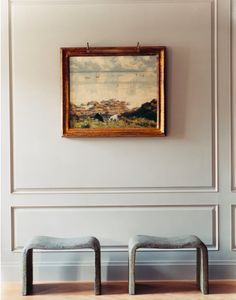 Love the simplicity of the old world art, gray walls and modern benches