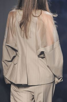Pinstripe suit jacket with sheer panels; fashion details // Jean Paul Gaultier Spring 2013