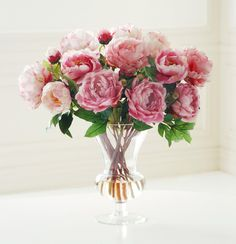 We have recreated fresh cut peonies for the peony lover so that they will never wilt on you again. Our permanent peonies in a mix of soft shades of pink features the flower's beautiful thick layers of petals to resemble garden fresh blooms. A flaired glass vase adds to the femininity of this simple look. Our peonies are a classic favorite.