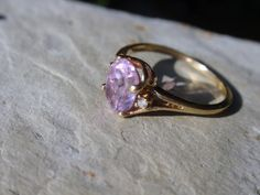 Sweet ladies 10k ring with an oval amethyst adorned with two round diamonds along each side. Beautiful pale lavender color. Shes right at a size 6 1/2, weighs 1.2g and her amethyst measures approx. 8mm x 6mm. Feel free to message me with any questions or if youd like more pics. And yes, we accept layaway!  I have more sweet treasures like this for sale in my shop. Please stop by and browse around.... https://www.etsy.com/shop/LuceesTreasureChest  Please note that all of my items are in…