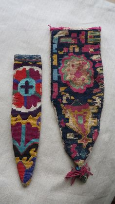 "Tajikistan- Lakai silk embroidered ceremonial knife holders. Circa 1900. larger one has cotton ikat backing. Size; larger one- 9"" by 3.1/2"" Smaller - 8"" by 2"""