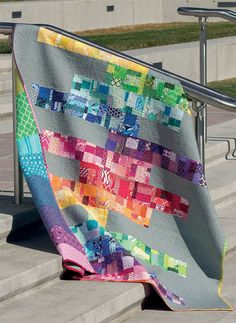 This beauty reminds us of rainbows - and Jenga - and good-old scrappy goodness! Find the pattern in Stash Statement by Kelly Young.