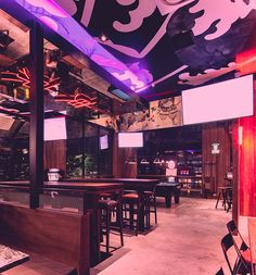 thai design studio PHTAA living design has completed the tokyo hustler restaurant as a blend of traditional japanese culture, anime and industrialization.