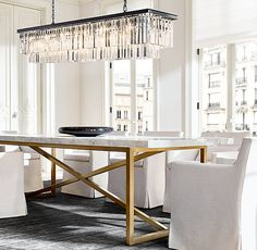 RH's Torano Marble Rectangular Dining Table:Designed by Timothy Oulton, our table exemplifies the cool minimalism of 1970s Italian design. Torano juxtaposes an austere X-base metal frame with a clean-edged, polished marble top.
