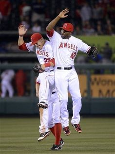 Game #54 6/2/12: Los Angeles Angels center fielder Mike Trout, left, and right fielder Torii Hunter celebrates after they defeated the Texas Rangers 3-2 in their baseball game, Saturday, June 2, 2012, in Anaheim, Calif. (AP Photo/Mark J. Terrill)