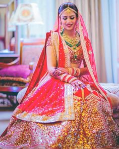Bride Ekta Bansal cuts a pretty picture in a custom designed red lehenga by teamed with layered necklaces. Double tap if you love her look. Indian Bridal Fashion, Indian Bridal Wear, Indian Wear, Asian Bridal, Red Lehenga, Bridal Lehenga, Wedding Lehanga, Indian Dresses, Indian Outfits