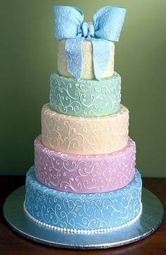 Five tiered Pastel cake with lace details, and a large fondant bow on top