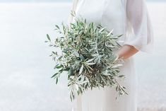 Intimate Meganisi Vow Renewal with Olive Details - Lefkas Weddings - Olive bride bouquet natural bouquet greenery wedding greece beach wedding