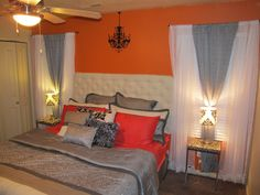 I love the orange wall and the DIY white headboard!!