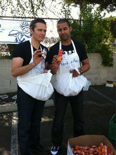 Seamus Dever and Jon Huertas volunteering to help feed the homeless.